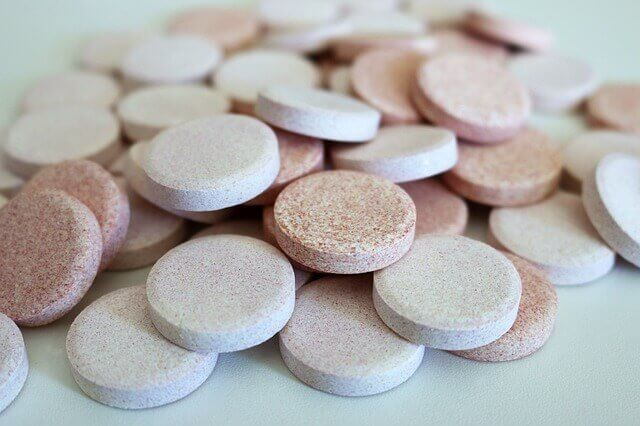 Image of a mix of drugs and pills showing drug misuse.