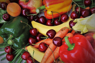A colorful mixture of peppers, carrots, vherries, apricots, banansa and other fruit and vegetable that contain fiber which helps prevent constipation.