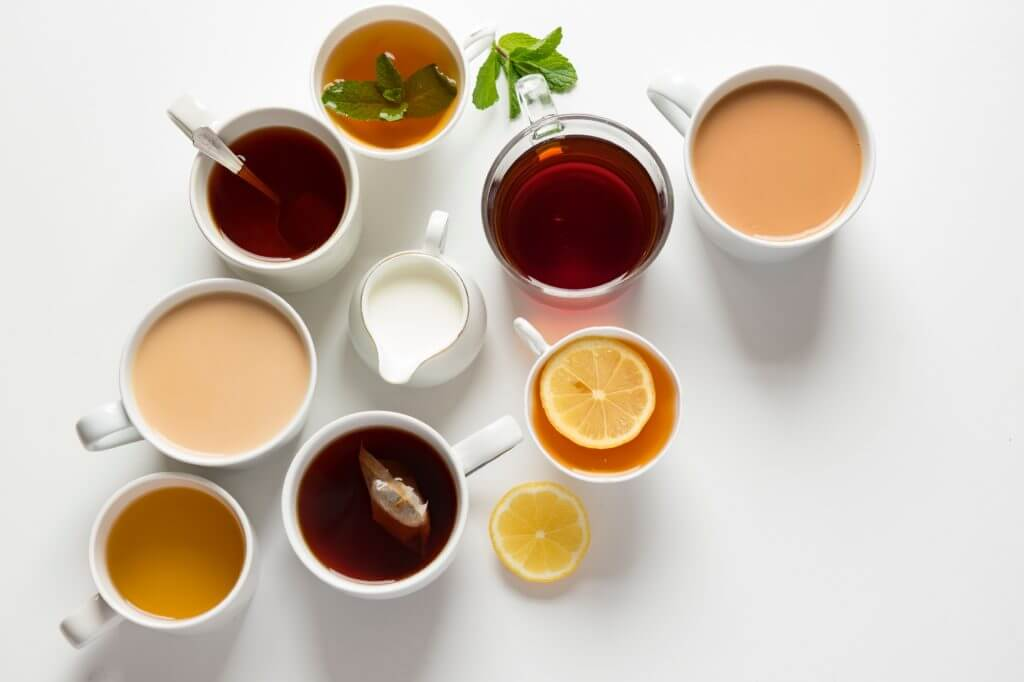 Picture showing several teacups holding a range of dfferent types of tea.