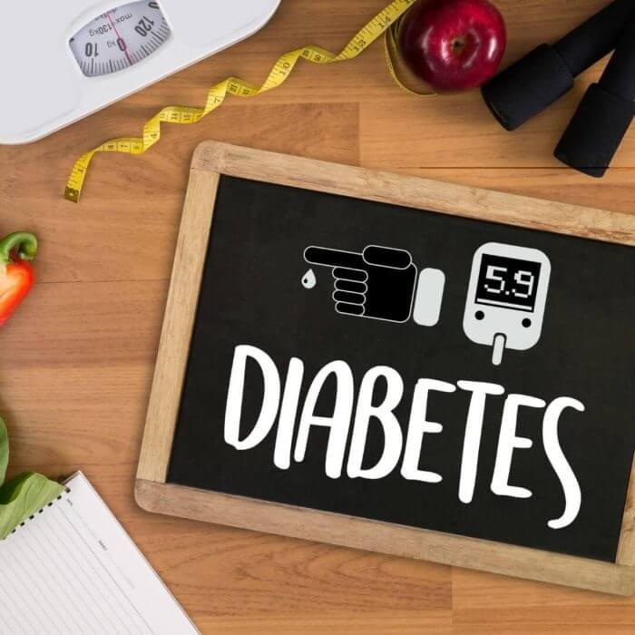 Wooden sign with 'Diabetes' written on