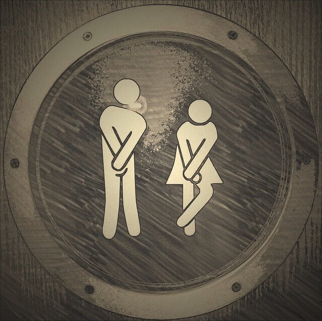 Man and Woman desperate for a toilet!