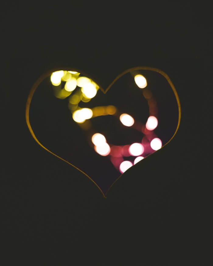 image of a heart with shining lights enclosed
