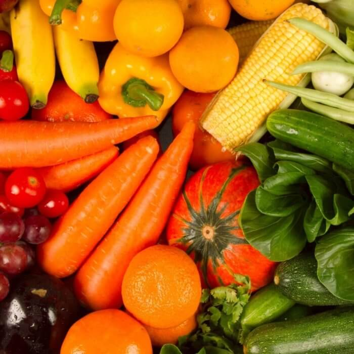 Spread of yellow, orange and green vegetables - Eating superfoods is one of the essential aspects of Biohacking