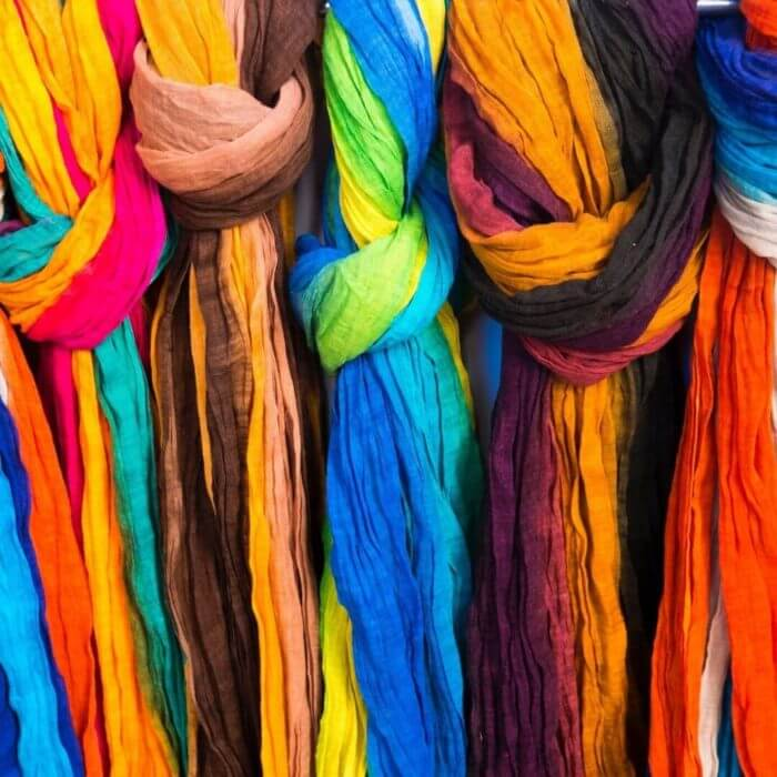 An array of bright multicoloured dyed cloths