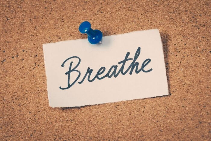 worrying about my health ? Word breathe pinned on a cork display board.